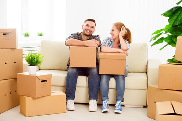 moving to a new apartment. Happy family couple and cardboard box