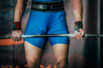 male powerlifter and barbell during competition of powerlifting deadlift