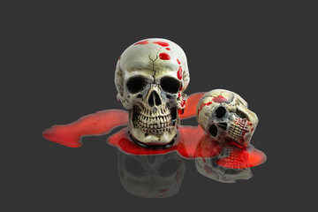 Still Life Human Skull with red blood on gray background. Skeleton and Skulls for HALLOWEEN FESTIVAL.