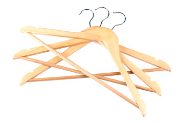 many wooden hangers on white isolated background