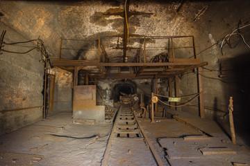 underground abandoned iron mine ore tunnel with rails Ural