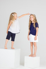 Sisters play and smile in studio