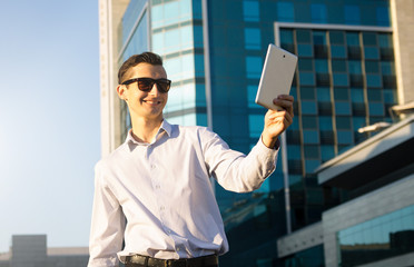 Businessman in financial district with a tablet