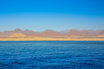 View on red mountains from the sea