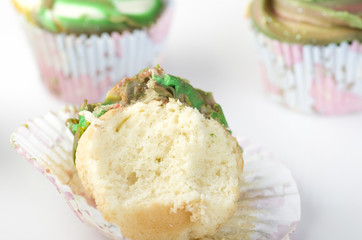 Home baked tasty cup cake, muffin with frosting on top isolated on white background.