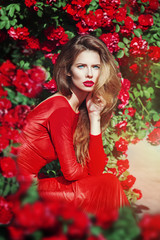 Vintage portrait of beautiful gorgeous woman in red dress in the