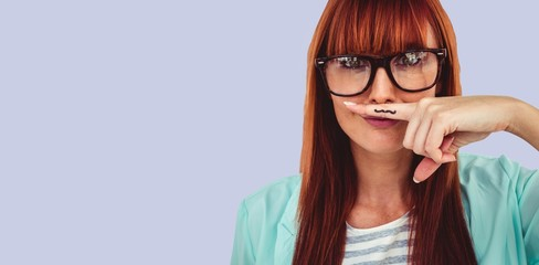 Composite image of happy smiling hipster with a mustache