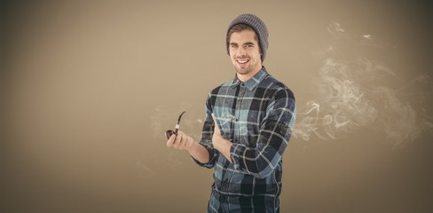 Composite image of portrait of happy man holding smoking pipe
