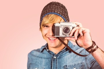 Composite image of smiling hipster man taking picture