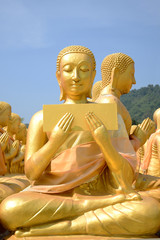 Close up of Thousand Golden Buddha statues