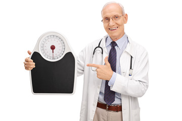 Mature doctor holding a weight scale