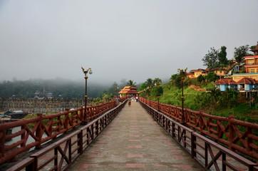 People travel and walk on Saphan Mon wooden bridge in morning ti
