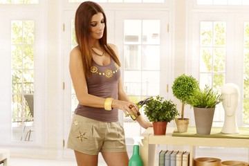 Young woman gardening at home