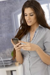 Attractive woman using mobilephone