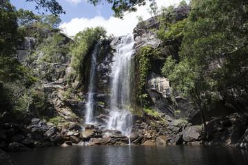 Cascada grande con abundante agua en el medio de una foresta. Cooktown, Queensland, Australia Wall mural
