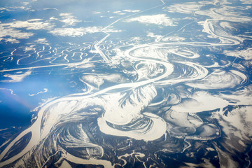 Aerial view of the river in time of sunny winter day.