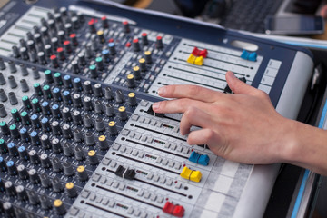 mixing panel. a hand of the person on the mixing panel