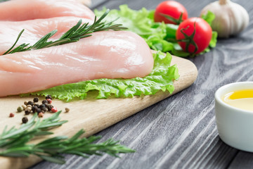 Chicken fillet on a cutting board.