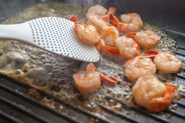 Grilled shrimps on frying pan.