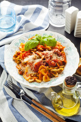 a plate of pasta farfallе with tomato sauce and green peas. hea