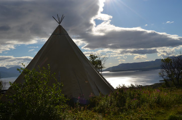 Wigwam in a meadow in subarctic valley, Bjorkliden, Swedish Lapland