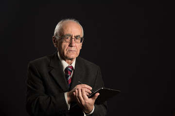 senior businessman with tablet pc