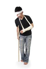 Man walking with crutch full length