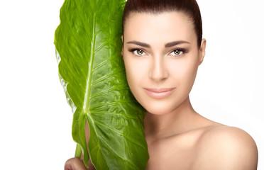 Beauty Spa Girl near Green Leaf over White Background