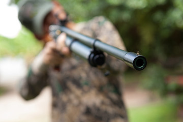 hunter holding a rifle and waiting for prey, hunter shooting