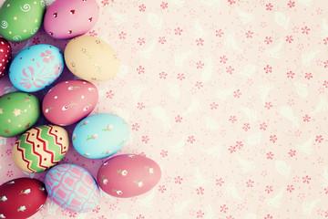 Vintage pastel easter eggs over flower patterned background