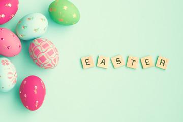 Vintage pastel easter eggs over mint background