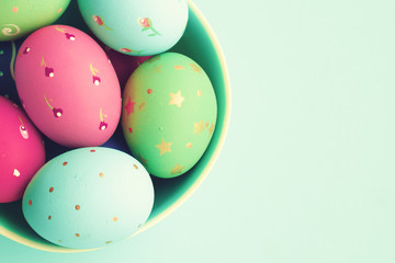 Vintage pastel easter eggs over mint background