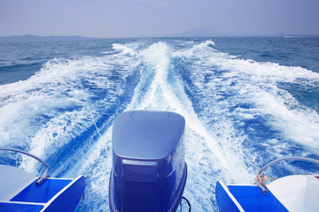 rear view of speed boat running high speed on blue sea water use