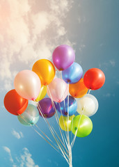 multicolor balloons with a retro filter effect, concept of happy birthday in summer and wedding honeymoon party (Vintage color tone)