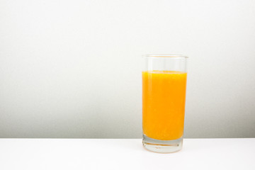 The glass of tasty pure orange juice for a good healthy.