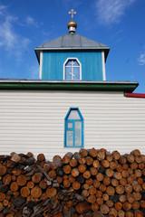 Woodpile at christian church building