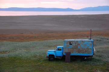Old broken truck adapted as shed at tundra island
