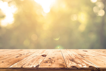 Top of wood table with blurred bokeh nature background - Empty ready for your product display or montage.