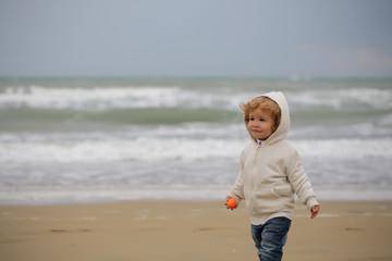 Baby boy in hooded coat
