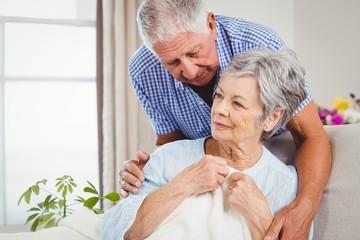 Senior man embracing woman at home