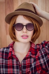 beautiful hipster woman in a hat and sunglasses