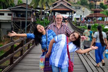People travel and portrait on Saphan Mon wooden bridge in mornin