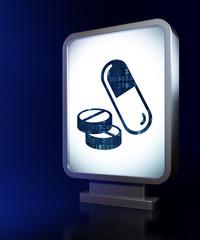 Medicine concept: Pills on billboard background