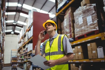 Warehouse worker on a phone call