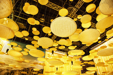 Futuristic yellow hanging decoration on the exhibition
