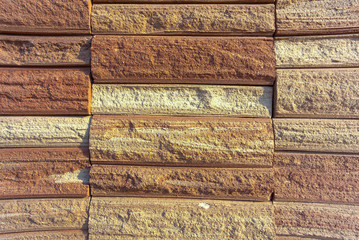 Close up stone brick tile wall aged texture detailed pattern background
