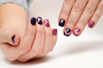 exclusive manicure on short nails in shades of purple