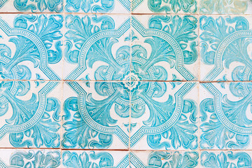 Close up image of the beautifully decorated tiles on the houses in the streets of Lisbon, Portugal
