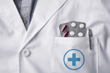Gown doctor with blisters pills in pocket