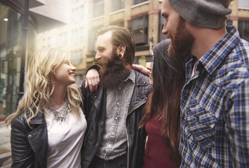 Four hipsters meeting in the city centre